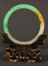 Translucent finely carved three-tone jadeite bangle