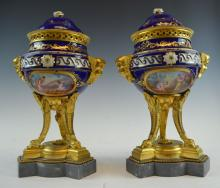 A Pair of Sevres Style Covered Urns