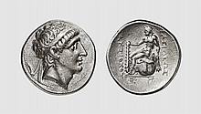 SYRIA, A SILVER TETRADRACHM OF ANTIOCHOS I, Magnesia ad Sipylum, ca. 280-261 BC. 16.936g, 1h. SC 318B. Old cabinet tone. Extremely fine. Acquired privately from Tradart fine The obverse features the diademed Antiochos in his old age. His portrait was
