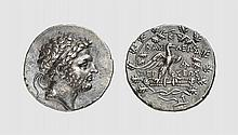 MACEDON, A SILVER TETRADRACHM OF PERSEUS, Amphipolis, ca. 173-171 BC, 15.364g, 11h. Mamroth 24. Old cabinet tone. Perfectly centered and struck. Unusual artistic dies. Choice extremely fine. Acquired privately from Tradart