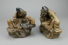 Pair of Chinese Jigong Pottery Figures