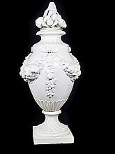 AN ITALIAN MAJOLICA WHITE GLAZED COVERED URN
