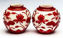PAIR OF CHINESE RED CASED PEKING GLASS SPHERICAL VASES