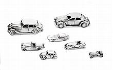 GROUP OF SEVEN MINIATURE SILVER AUTOMOBILE MODELS