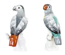 TWO GERMAN PAINTED PORCELAIN PARROTS & A DRESDEN SWAN