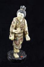 A CARVED IVORY FIGURE PROBABLY CHINESE