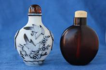 Two Chinese Glass Snuff Bottles and Stoppers,