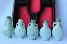 Set of Five Chinese Pale Celadon Snuff Bottles and