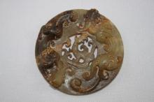 Chinese Brown and Celadon Jade Bi Disc,