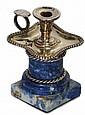 ETOUFFOIR 1900  En argent quadrilobé, reposant sur une colonne en lapis-lazuli. Poinçon.   Hauteur : 10 cm