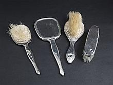 A COLLECTION OF SILVER DRESSING TABLE BRUSHES and