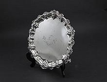 A VICTORIAN SILVER SHAPED CIRCULAR SALVER, London