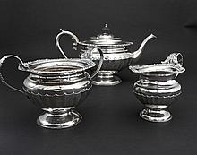 AN EDWARDIAN THREE PIECE SILVER TEA SET, London
