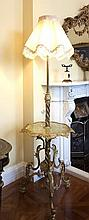 A GILT METAL STANDARD LAMP TABLE, in Rococo revival style, the telescopic s
