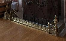A FRENCH CAST BRASS ADJUSTABLE CURB FENDER in the Neo-Classical taste with
