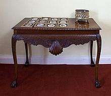 A GEORGE III STYLE MAHOGANY RECTANGULAR SIDE TABLE, the top with gadroon ri