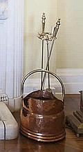 A BRASS FIRE TIDY AND A COPPER COAL SCUTTLE, with brass handle