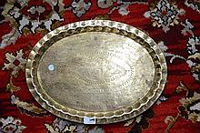 A CHINESE GILT METAL OVAL TRAY, Hong Kong,   with dimpled rim, decorate