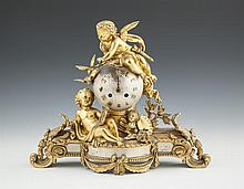 A FRENCH ORMOLU AND POLISHED STEEL MANTLE CLOCK, 19th century, representative of the arts, the globular dial with applied Roman numerals and surmounted by a winged cupid and doves above a reclined figure holding painting and trophies, over shaped bas