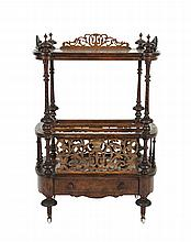 A VICTORIAN BURR WALNUT MUSIC CANTERBURY, of upright rectangular form, the platform top with pierced fretwork gallery on spiral turned supports above three divisions and single drawer frieze, turned feet and porcelain castors. 102cm high, 70cm wide
