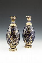 A PAIR OF ROYAL CROWN DERBY GILT EMBELLISHED OVOID VASES , c.1900, each with deep blue ground decorated with moulded and gilded foliate motifs