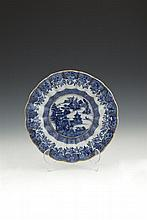 A CHINESE BLUE AND WHITE DISH, Kangxi period, late 17th/early 18th century, painted to the centre with pagodas against a rocky river landscape, within a raised moulded border with multiple lobed segments and gilt edged rim. 25cm diameter