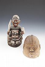 AN AFRICAN CARVED TRIBAL ART GROUP, YUROBA, NIGERIA, modelled as a figure on horse back; together with a Pende helmet mask, 19th/20th Century. (2)