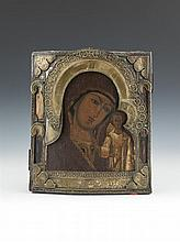 A RUSSIAN BRASS OVERLAID ICON, late 19th century, depicting Madonna and Child, oil on poplar panel. 36 x 31cm