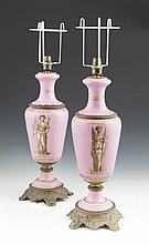A PAIR OF VICTORIAN PINK PORCELAIN BALUSTER TABLE LAMPS, decorated with Classical Roman figures, transfer printed, and with brass oxidised bases, adapted for electricity. 45cm high