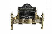 A GEORGE III BRASS AND CAST IRON FIRE GRATE, of serpentine form, with engraved pierced brass grill and flanked by tapering upright supports with urn finials. 66cm high, 82cm wide; together with assorted fire brasses.