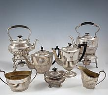 A MATCHED SEVEN-PIECE SILVER TEA AND COFFEE SET, various marks, each of oval form, decorated with de
