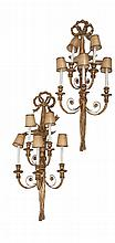 A PAIR OF CARVED GILTWOOD FIVE LIGHT WALL SCONCES, surmounted with a tied ribbon above an eagle with