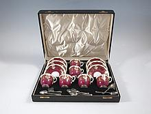 A ROYAL WORCESTER SIX PIECE COFFEE SET, early 20th century, within a fitted case; together with a se