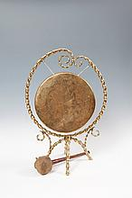 A BRASS DINNER GONG AND STAND