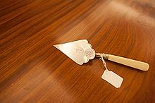 A SILVER PLATED PRESENTATION TROWEL, fitted with