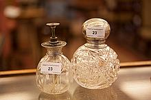 A SILVER MOUNTED CUT GLASS PERFUME BOTTLE, with