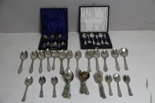 A CASED SET OF SIX SILVER PLATED TEA SPOONS; together with another similar; and a large miscellaeous collection of silver plated tea spoons and pastry forks. (55)