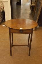 A VICTORIAN MAHOGANY OVAL TOP SIDE TABLE on square supports. 64cm wide