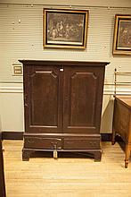 AN IRISH OAK PROVINCIAL LINEN PRESS, C. 1740, with moulded cornice above a pair of fielded panelled doors, the base with two drawers and on tall bracket feet. 120cm wide x 150cm highProvenance: The Estate of Anne Yeats (1919 - 2001);HOK Fine Art S