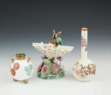 A ROYAL WORCESTER POLYCHROME PORCELAIN FANTASTICAL SEA SHELL VASE surmounted with a green dragon and raised on a sea shell strewn base; a globular vase in the Japanese taste with twin gilded handles and raised on three ball feet; together with a sing