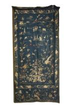A CHINESE SILK EMBROIDERED RECTANGULAR PANEL, the central vignette depicting a female figure fighting two warriors, further decorated with birds and foliage in garden landscape, on a deep blue ground. 237cm long