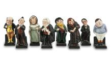 A SET OF EIGHT ROYAL DOULTON CARICATURE PORCELAIN FIGURES, depicting various characters from Dickens' novels, comprising Tony Weller, Fat Boy, Fagin, Mrs. Bardell, Buzfuz, Pecksniff, Pickwick and Stiggins. Each approx. 10.5cm high