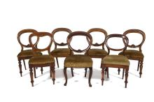 A HARLEQUIN SET OF EIGHT VICTORIAN MAHOGANY BALLOON BACK DINING CHAIRS