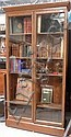 A late Victorian simulated oak tall bookcase with