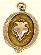 A white metal medal of shaped oval form inscribed