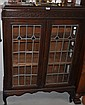 An early 20th century oak glazed display cabinet