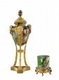 ROUSSEAU François-Eugène (1827- 1891) et LEVEILLE Ernest (1841-1913) et E. ENOT PARIS Petit vase cylindrique en verre doublé épais craquelé à jaspure intercalaire brune, rose et verte reposant sur une base circulaire pansue en bronze à décor ajouré