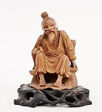 Carved Wood Seated Figure