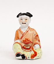 Seated Child Figure