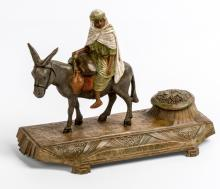 Orientalist Inkwell, (France, 20th Century), polychrome painted metal, representation of a man on a donkey with water flasks in metal, 9.5 x 15.5 x 6.5 cm